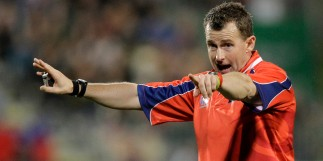 Referee Nigel Owens gestures to the players during the Rugby World Cup game between Samoa and South Africa at North Harbour Stadium in Auckland, New Zealand, Friday, Sept. 30, 2011. (AP Photo/Themba Hadebe)